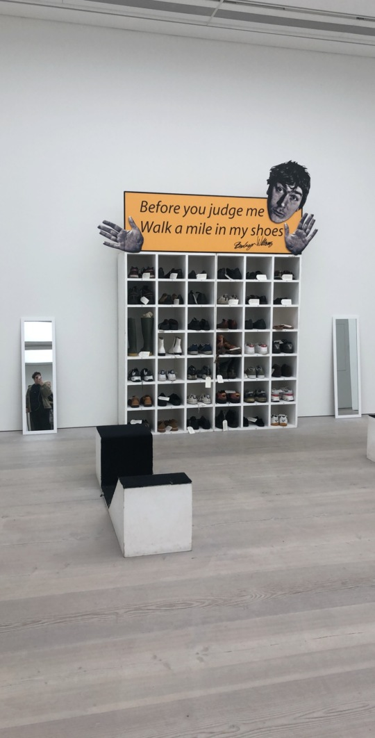 2006 Installation with size 13 shoes, written notes, poster, shelving and foot-rests